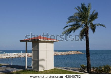 changing cubicle at the beach - stock photo