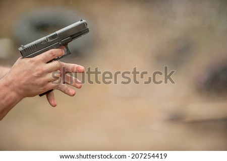 Changing Pistol Clip. Outdoor Shooting Range - stock photo