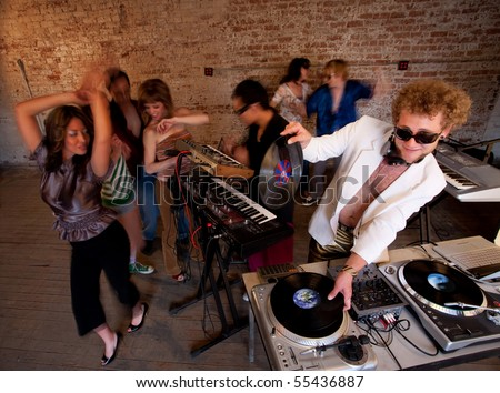 Changing records at a 1970s Disco Music Party - stock photo