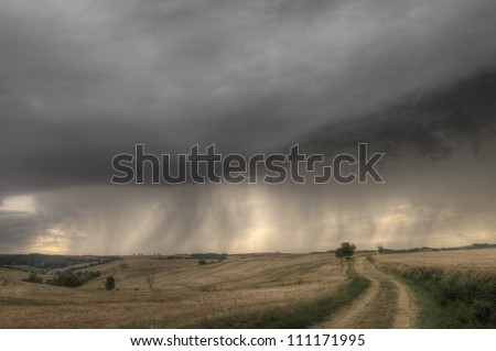 changing stormy weather on french country on early evening - stock photo
