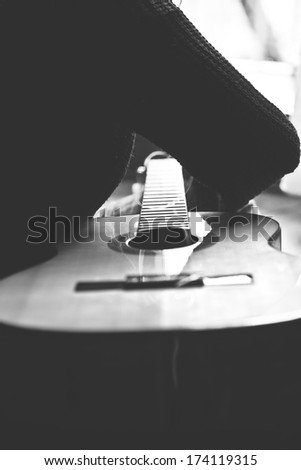 changing strings on classic guitar - stock photo
