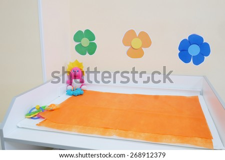 Changing table in the office of a pediatrician - stock photo