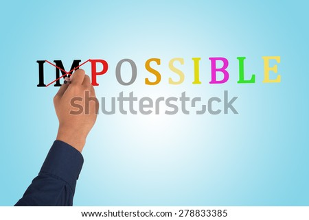 "Changing the word impossible to possible using ballpoint, hand erase letters ""IM"" from word ""IMPOSSIBLE"" on gradient blue background."