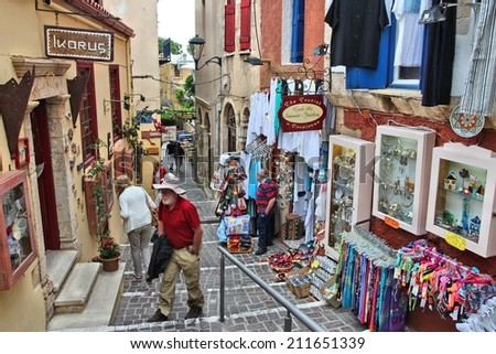 CHANIA, GREECE - MAY 18, 2014: People visit Old Town of Chania, Crete. Chania is the 2nd largest municipality in Crete (108,642 inhabitants in 2011). - stock photo