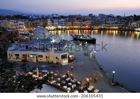 Chania, town on Crete island in Greece. Old town and harbor is surrounded by the old Venetian fort that started to be built in 1538 - stock photo