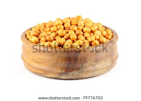 Channa - deep-fried spiced chick peas in a wooden bowl isolated on a white background. - stock photo
