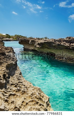Channel of clear water between Ironshore (limestone) rocks at Smith Cove, Grand Cayman - stock photo