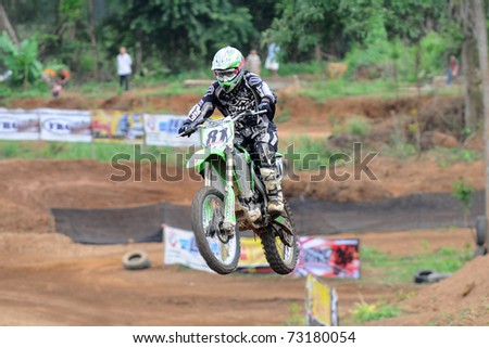 CHANTABURI, THAILAND - FEB 7: Unidentified rider in action at Thailand motocross championship 2010 first round on February 7, 2010 in Chantaburi, Thailand.