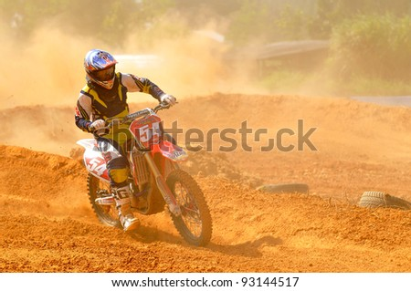 CHANTABURI, THAILAND - NOV 20: An unidentified rider participates in the final round of the 2011 Thailand motocross championship on November 20, 2011 in Chantaburi, Thailand. - stock photo