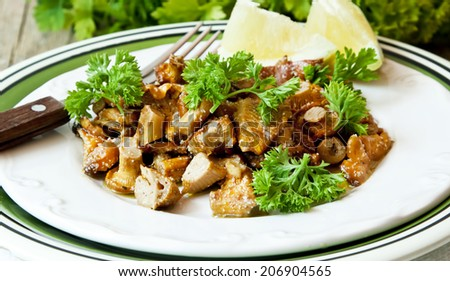 Chanterelle Mushrooms Stew with Garlic and Parsley - stock photo