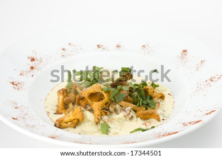 chanterelles and gnocchi pasta on a plate