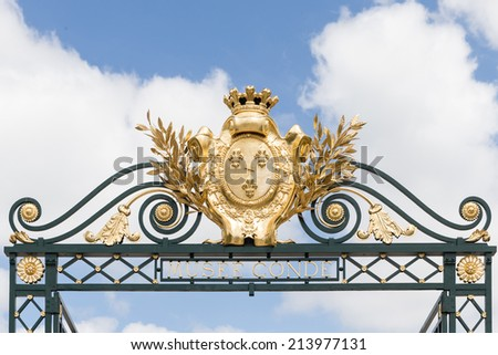 CHANTILLY, FRANCE JUNE 19, 2014:view of decoration of the gate in Chantilly castle of France on June 19, 2014. It is a historic castle located in the town of Chantilly. It houses the Museum of Conde