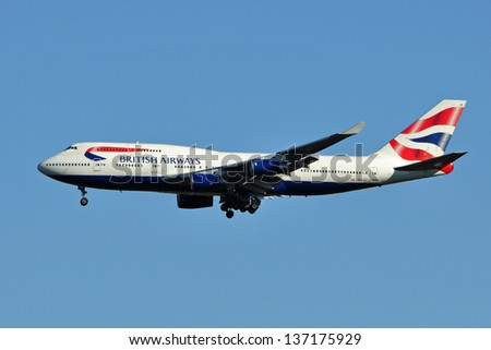 CHANTILLY, VA, USA - NOVEMBER 5, 2011: British Airways Boeing 747 lands at Dulles International Airport. British Airways is the flag carrier airline of the United Kingdom. - stock photo