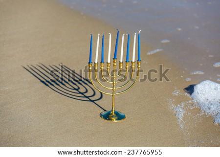Chanukah Menorah on the beach  - stock photo