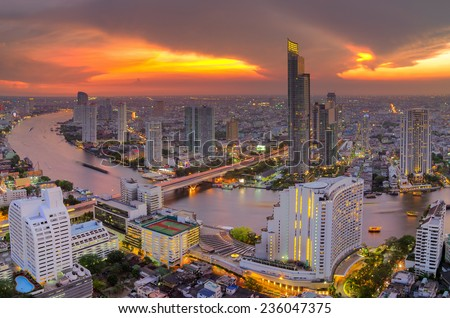 Chao Phraya River Landscape And the business district of Bangkok Dramatic sky - stock photo