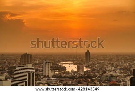Chao Phraya River Landscape sunset And the business district of Bangkok Dramatic sky