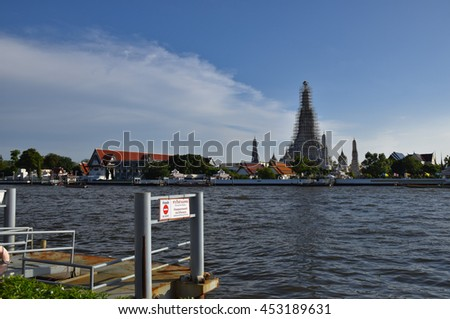 Chaophraya River port in front Wat Arun, Temple of Dawn, Bangkok, central of Thailand  - stock photo