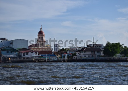Chaophraya River port opposite Europe style church, Bangkok, central of Thailand, blue sky, blue sky cloud,