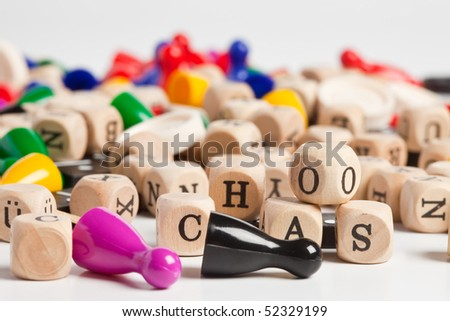 chaos of plastic figures, cubes and domino - stock photo