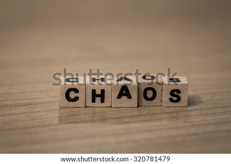 Chaos written in wooden cubes on a desk