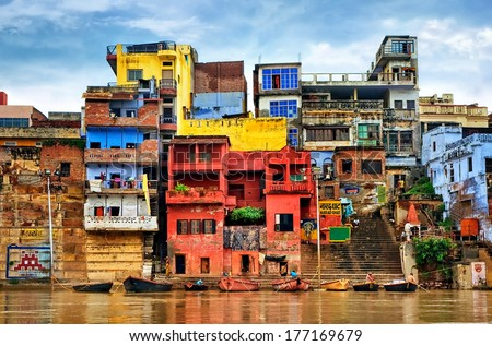 Chaotic colorful houses on the banks of river Ganges, Varanasi, India - stock photo