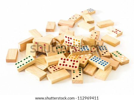 Chaotic heap of wooden domino on white background - stock photo
