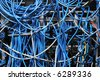 chaotic mess of network cables all tangled together - stock photo