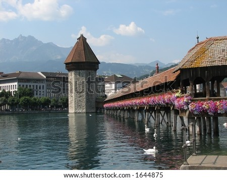 Chapel Bridge in Lucerne with flowers in full bloom