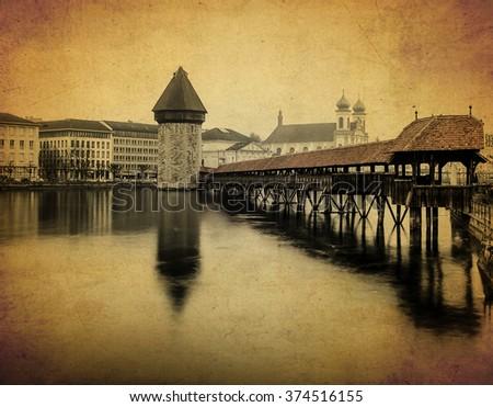 chapel bridge, one of the famous landmark of Luzern, Switzerland in old paper background - stock photo