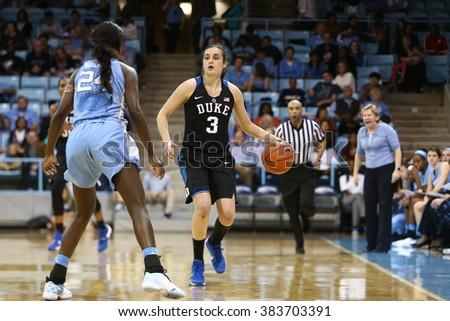 CHAPEL HILL, NC-FEB 28: Duke Blue Devils guard Angela Salvadores (3) dribbles as University of North Carolina Tar Heels guard Destinee Walker (24) defends on February 28, 2016 at Carmichael Arena. - stock photo