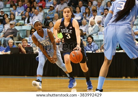 CHAPEL HILL, NC-FEB 28: Duke Blue Devils guard Angela Salvadores (3) dribbles as University of North Carolina Tar Heels guard Jamie Cherry (10) gives chase on February 28, 2016 at Carmichael Arena. - stock photo