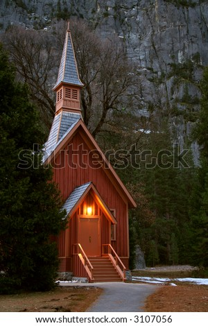 chapel in yosemite national park at base of granite cliff - stock photo