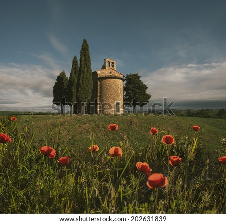 Chapel of St. Madonna Vitaleta with blooming poppies. Tuscany, Italy. Retro film effect - stock photo