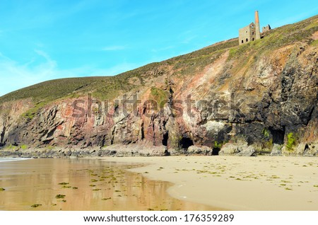 Chapel Porth beach and cliffs at low tide near St Agnes in Cornwall England - stock photo