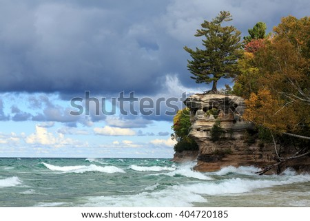 Chapel Rock is battered by crashing waves from Lake Superior at Pictured Rocks National Lakeshore in the Upper Peninsula of Michigan - stock photo
