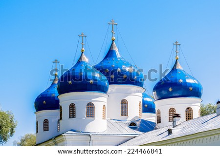 Chapels of the St. George's (Yuriev) Monastery, Russia's oldest monastery. It is part of the World Heritage Site named Historic Monuments of Novgorod and Surroundings. - stock photo