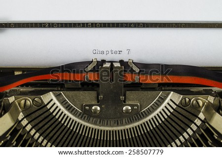 Chapter 7 word printed on an old typewriter - stock photo