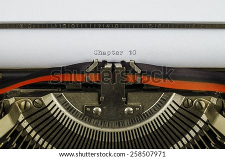 Chapter 10 word printed on an old typewriter - stock photo