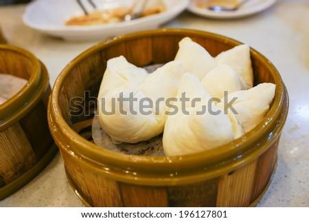 Char Siu Bao - Chinese steamed bun filled with bbq pork - Cantonese Dim Sum - stock photo