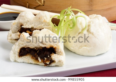 Char Siu Bao  - Chinese steamed bun filled with bbq pork - Cantonese Dim Sum - stock photo