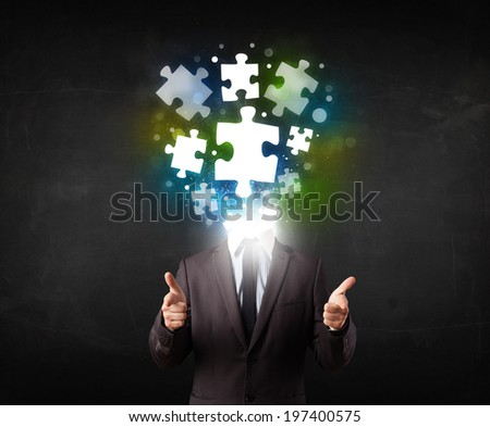 Character in suit with glowing puzzle head concept - stock photo