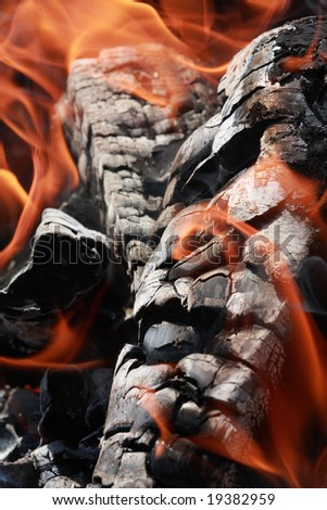 Charcoal and flame - stock photo