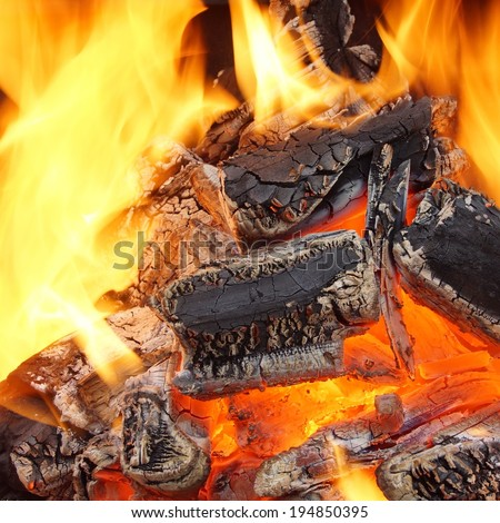 Charcoal Burning in BBQ or in the Fireplace. Frame Background and Texture. - stock photo