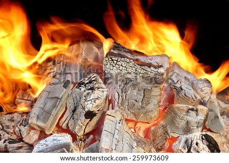 Charcoal Embers Close-up Background or Texture Isolated on Black - stock photo
