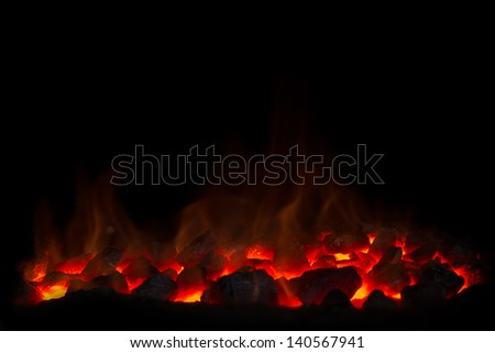 Charcoal fire black background - stock photo