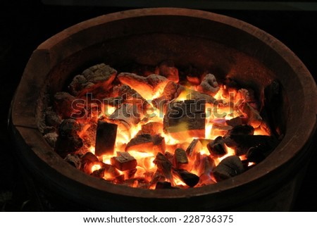 Charcoal fire on a black background. - stock photo
