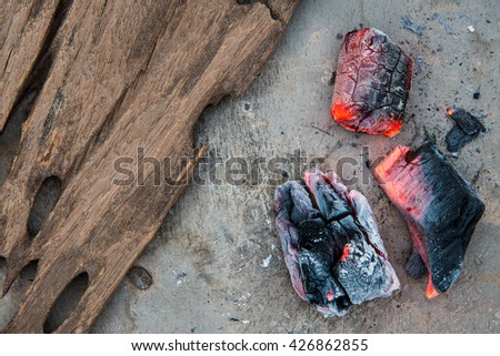 charcoal fire with wood on cement background - stock photo