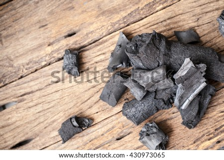 charcoal on wooden background - stock photo
