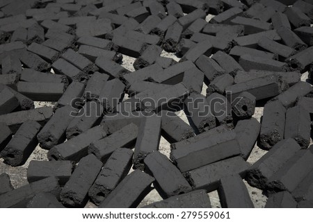 charcoal pack bar made from coconut shell background - stock photo