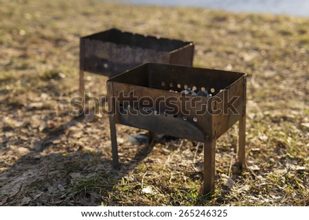 charcoal preparation for bbq in mangals - stock photo